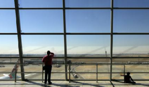runway from the main viewing room as South African Airlines jets